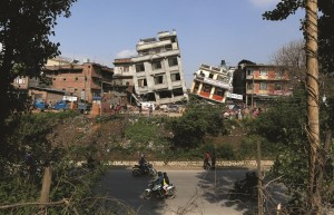 Damaged buildings lean to their sides in Kathmandu, Nepal, on Monday, April 27. (AP Photo/Wally Santana)