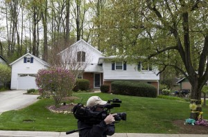 A cameraman works outside the Weinstein family home in Rockville, Md., Thursday. (AP Photo/Jose Luis Magana)