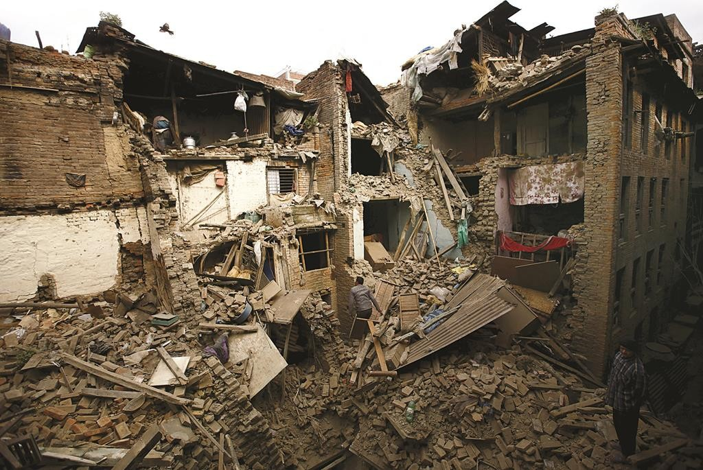People search for family members trapped inside collapsed houses a day after an earthquake in Bhaktapur, Nepal, on Sunday. (REUTERS/Navesh Chitrakar)