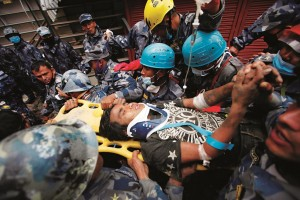 Pemba Tamang is carried on a stretcher Thursday, April 30, after being rescued from a building that collapsed five days ago in Kathmandu, Nepal. Crowds cheered Thursday as 15-year-old Tamang was pulled, dazed and dusty, from the wreckage of a seven-story building. (AP Photo/Niranjan Shresta)