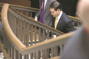 Republican Presidential candidate and Senate Foreign Relations Committee member, Sen. Marco Rubio (R-Fla.) departs a briefing on Iran nuclear negotiations, Tuesday. (AP Photo/Andrew Harnik)