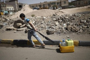 A boy pulls containers of water after he filled them at a faucet, amid an acute shortage of clean drinking water in Sanaa, Yemen, Monday. (REUTERS/Mohamed al-Sayaghi)
