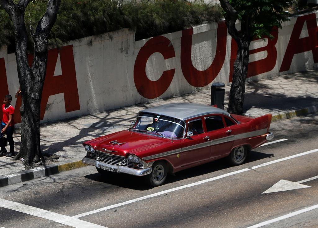 A taxi driver steers his classic American car through Havana, Cuba, Tuesday.  (AP Photo/Desmond Boylan)