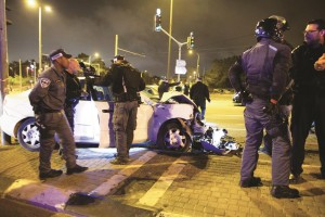 The scene where one Israeli was killed and several others injured when a car crashed into a bus station in French Hill, Yerushalayim. (Yonatan Sindel/Flash90)
