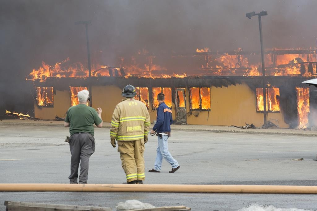 Firefighters work the scene of a fire at Mid-State Lumber in Warwick, N.Y., on April 2. (AP Photo/Times Herald-Record, Robert G Breese)
