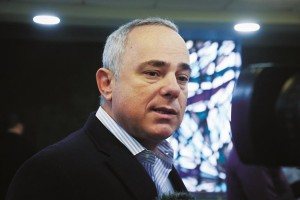 Minister of Intelligence Yuval Steinitz speaks with media before the weekly cabinet meeting.  (Marc Israel Sellem/POOL/Flash90)