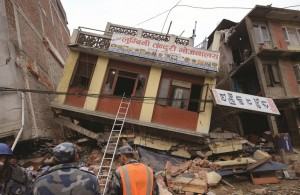 Nepalese rescue personnel observe damaged buildings following an earthquake in Kathmandu on Sunday April 26. (Prakash Mathema/AFP/Getty Images)
