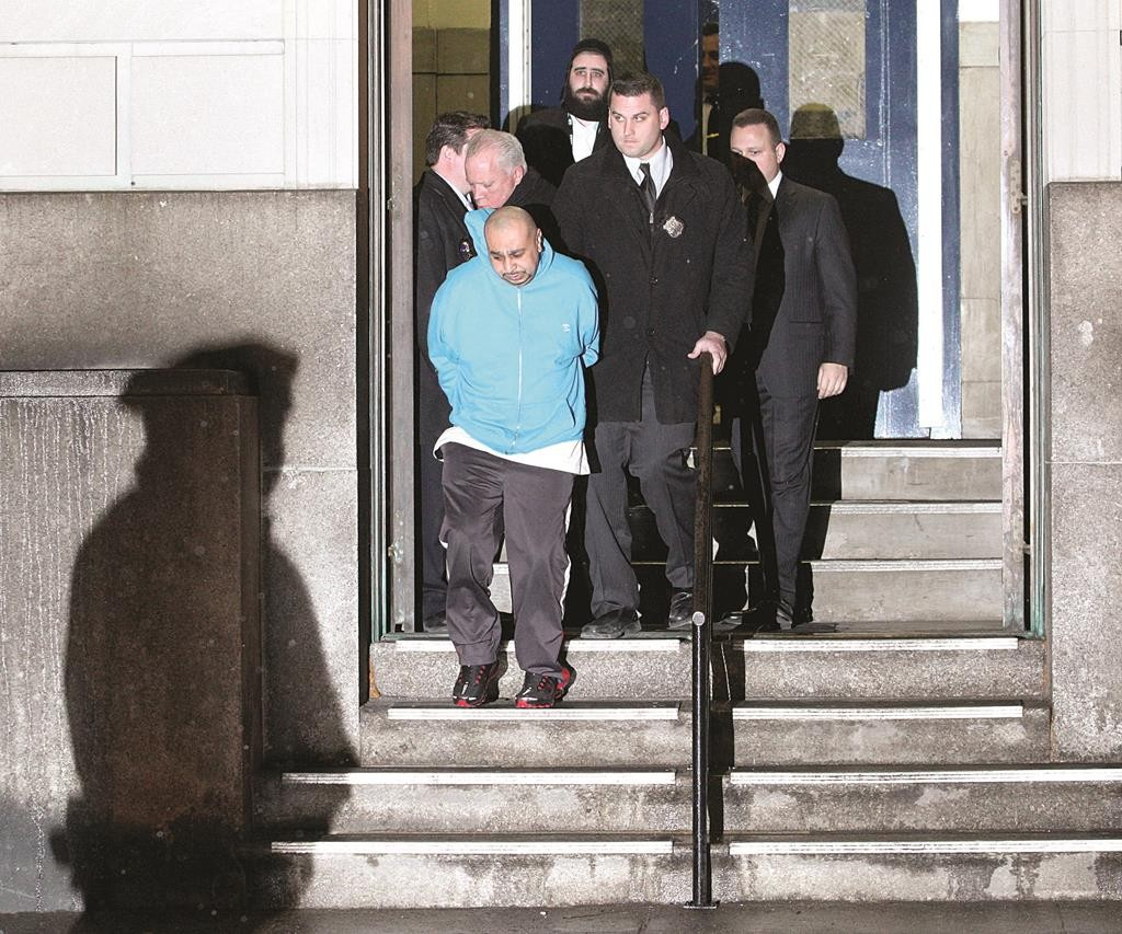 Julio Acevedo leaves Williamsburg's 78th Precinct after being booked on March 7, 2013. (Andy Jacobsohn/Getty Images)