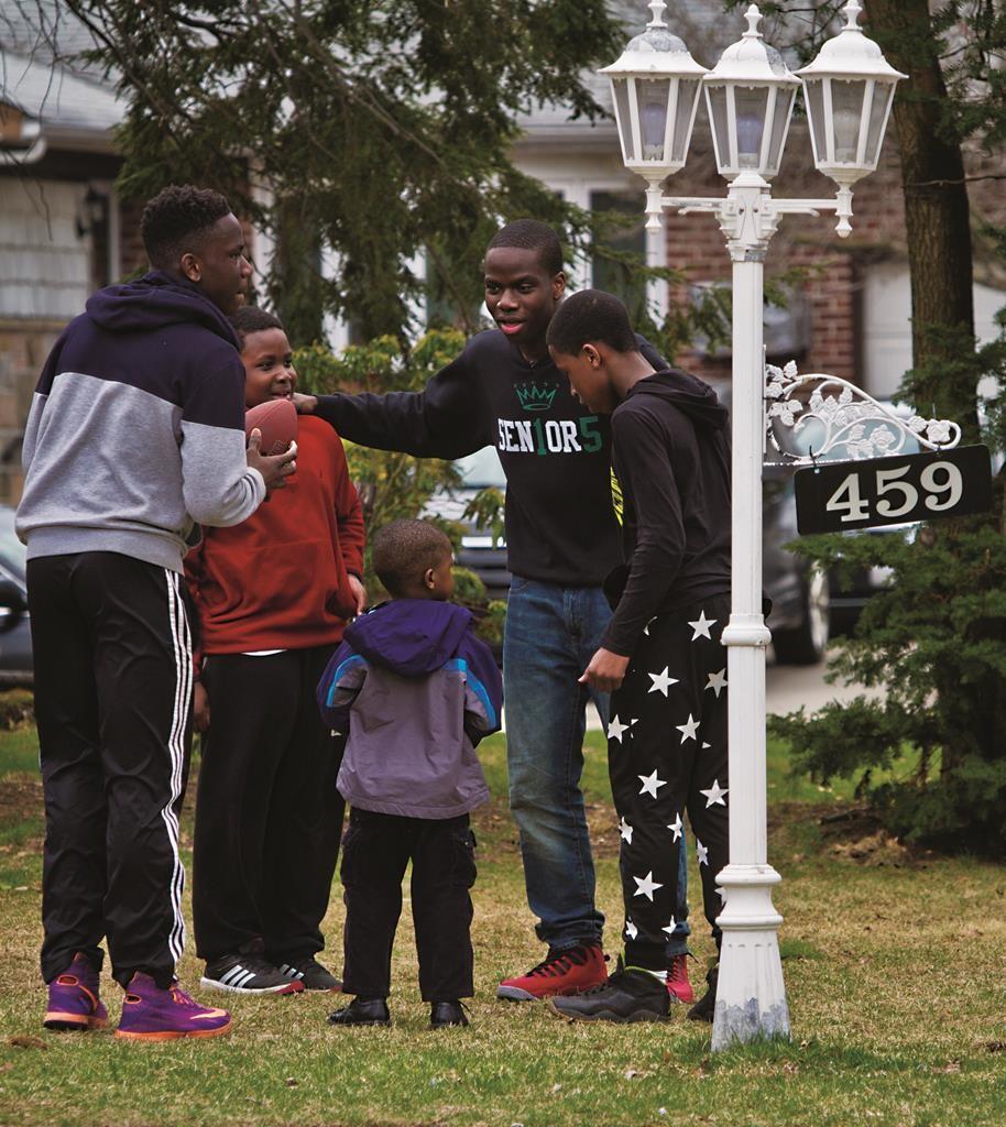 Harold Ekeh (2nd R) playing football with his four brothers last week. (AP Photo/Bebeto Matthews)