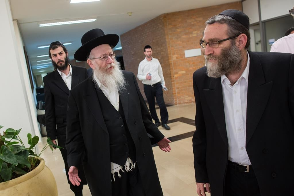 United Torah Judaism MKs Rabbi Yaakov Litzman (L) and Rabbi Moshe Gafni (R) arrive for a meeting with Likud representatives in the coalition talks. (Yonatan Sindel/FLASH90)