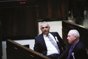 Moshe Kahlon (L), leader of the Kulanu party, during the recent swearing-in ceremony for the 20th Knesset. (Miriam Alster/Flash90)