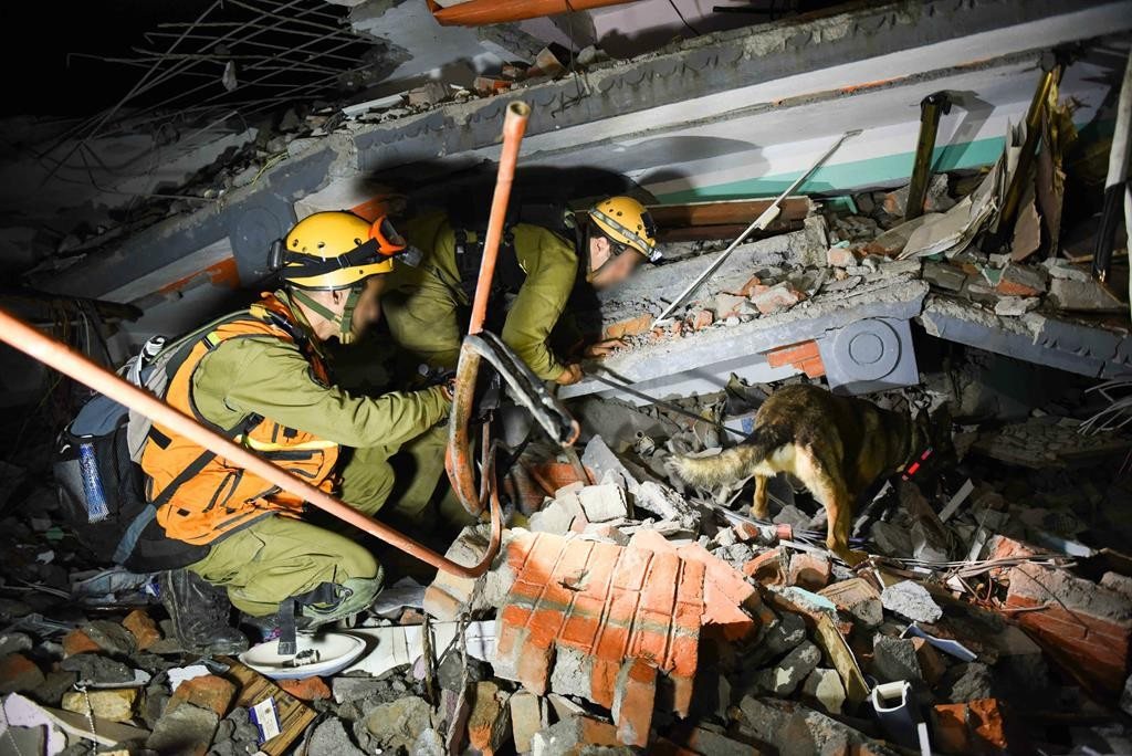Israeli soldiers searching for injured and trapped people in the ruins of a building in Nepal, Tuesday, following the deadly earthquake.