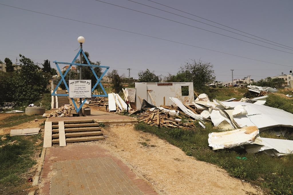 The Chazon David synagogue structure demolished by Israeli security forces on Monday night, near  Kiryat Arba. The synagogue was ordered removed after a court ruling that it was built illegally on Palestinian land.  (Gershon Elinson/Flash90)
