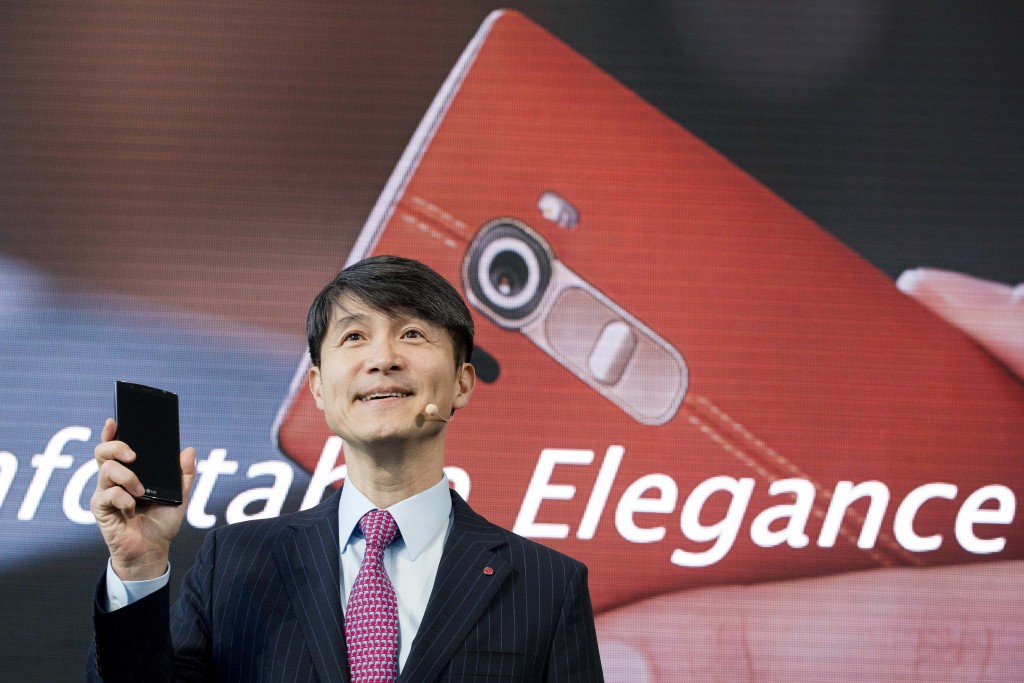 Juno Cho, LG's mobile chief, introduces the LG G4 during an event on Tuesday, April 28, 2015 in New York. LG is making smartphones with leather backs as it seeks to distinguish its phones from Apple's iPhones and Samsung's Galaxy smartphones. (AP Photo/Mark Lennihan)