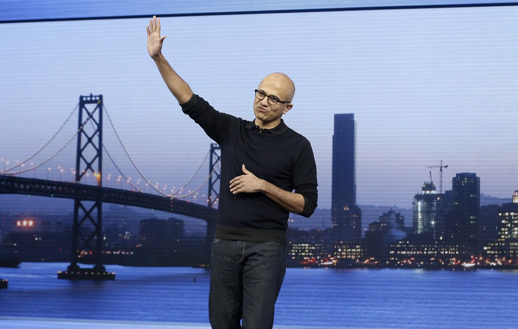 Microsoft CEO Satya Nadella waves after speaking at the Microsoft Build conference in San Francisco on Wednesday, April 29, 2015. While Microsoft has already previewed some aspects of the new Windows 10, a parade of top executives will use the conference to demonstrate more software features and app-building tools, with an emphasis on mobile devices as well as PCs. (AP Photo/Jeff Chiu)