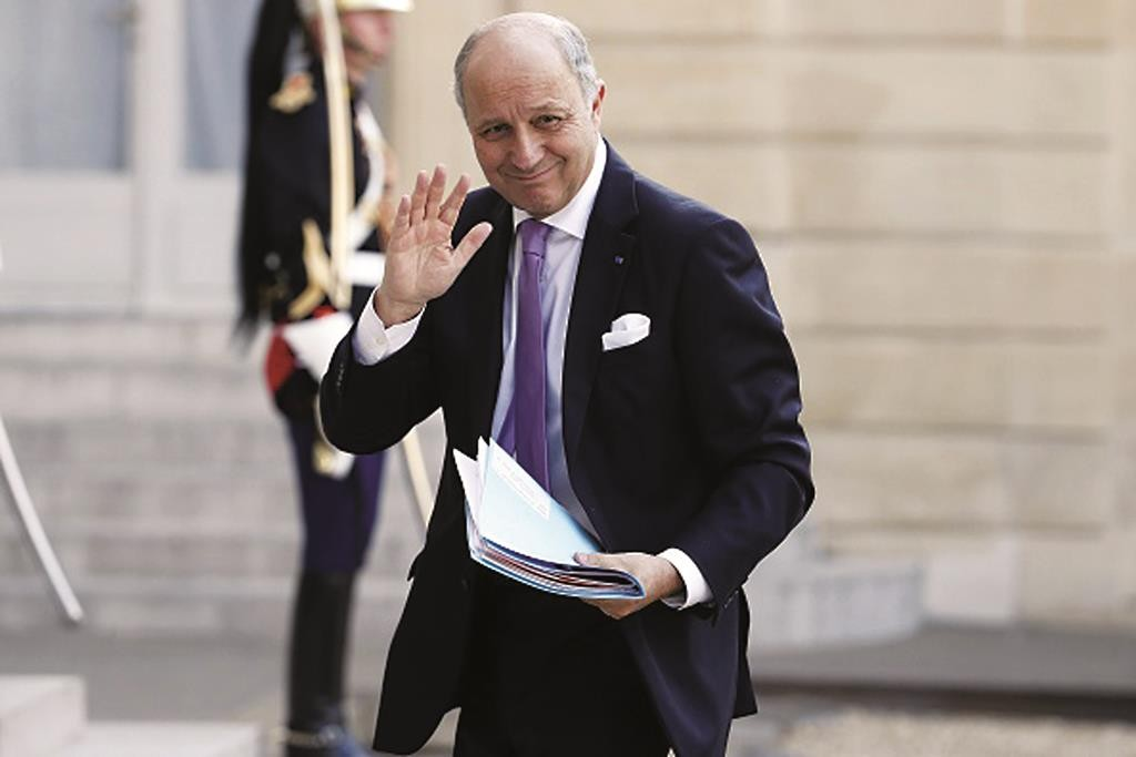 French Foreign Affairs Minister Laurent Fabius waves as he arrives to attend a meeting at the Elysee Palace in Paris, April 29.  (THOMAS SAMSON/AFP/Getty Images)