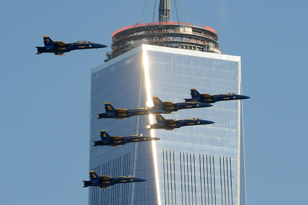 The Navy's Blue Angels flight demonstration team pass One World Trade Center in 2013. (AP Photo/The Jersey Journal, Reena Rose Sibayan)