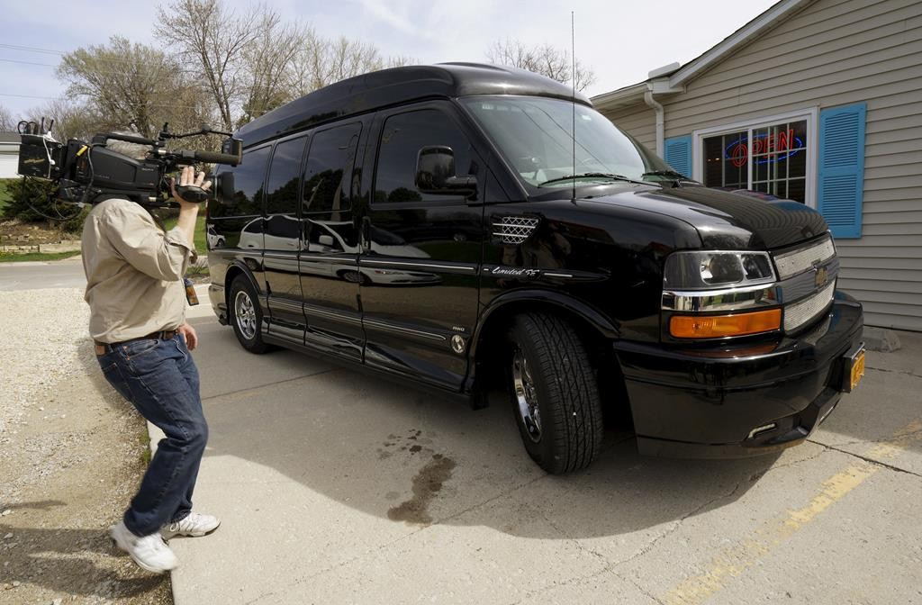 A cameraman records the van U.S. presidential candidate and former Secretary of State Hillary Clinton is using to cross the state to campaign for the 2016 Democratic presidential nomination, at the Jones Street Java House in LeClaire, Iowa, Tuesday.. (REUTERS/Rick Wilking)