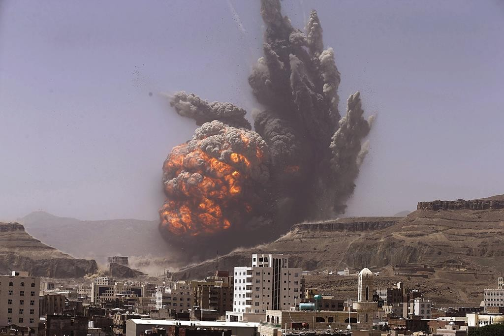 Smoke rises during an air strike on an army weapons depot on a mountain overlooking Yemen's capital Sanaa, Monday. (REUTERS/Khaled Abdullah)