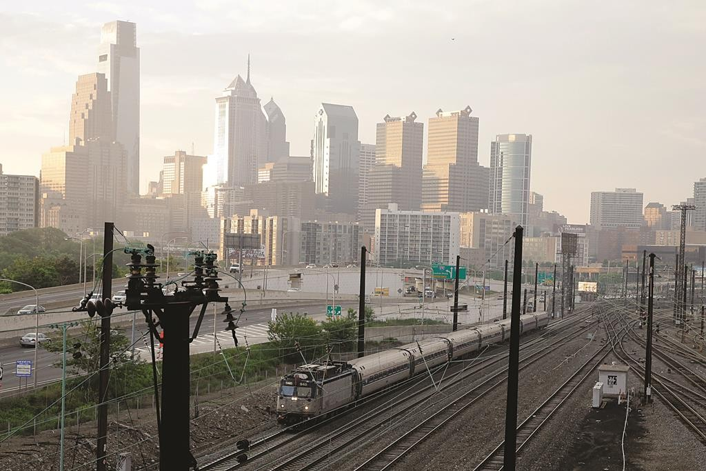 An Amtrak train travels northbound from 30th Street Station, Monday in Philadelphia.  (AP Photo/Matt Slocum)
