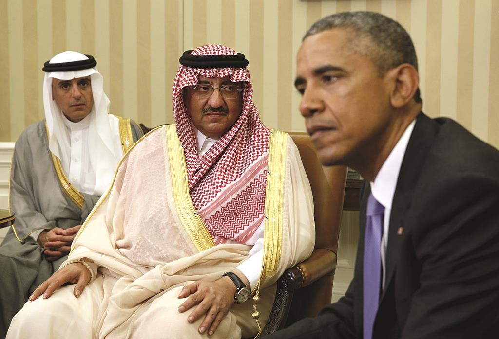 President Barack Obama meets with Saudi Crown Prince Mohammed bin Nayef (C) in the Oval Office of the White House in Washington Wednesday. At left is Saudi Foreign Minister Adel Al Jubeir.  (REUTERS/Kevin Lamarque)