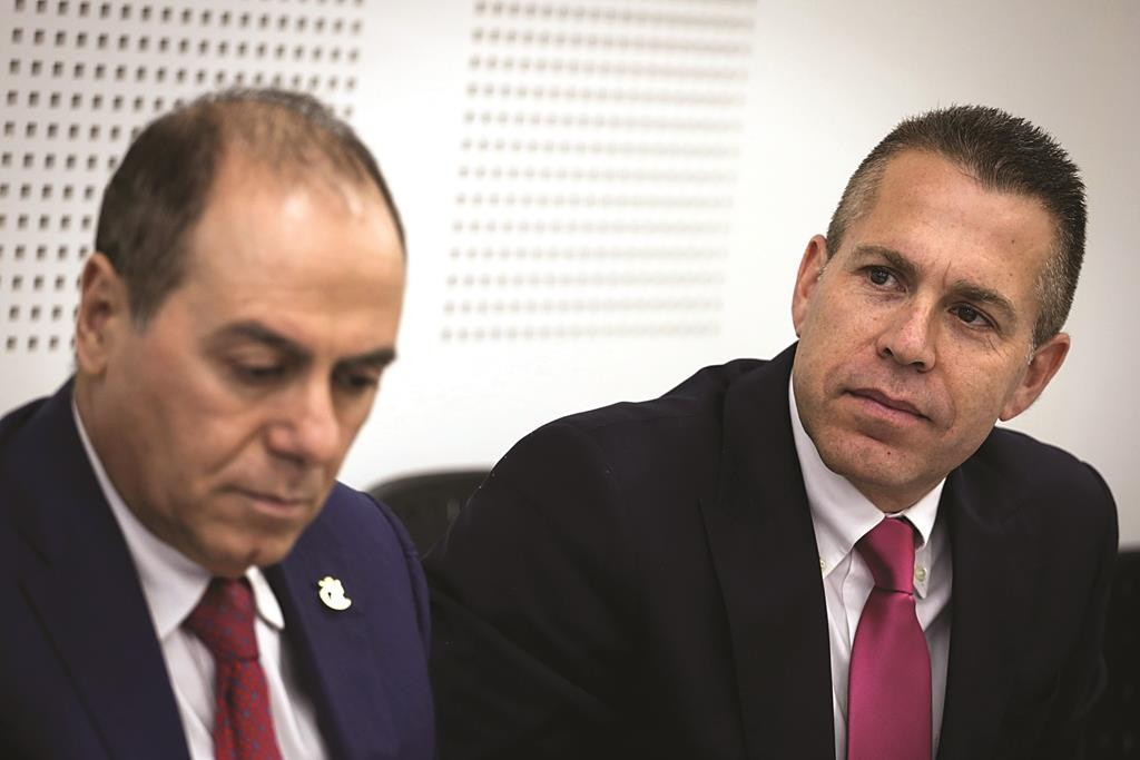 Newly-appointed Minister of Interior, Silvan Shalom (L) and outgoing minister Gilad Erdan (R) at a ceremony in Yerushalayim on Sunday. (Hadas Parush/Flash90)