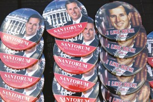 Buttons of former Pennsylvania Sen. Rick Santorum are seen ahead of his announcement that he is entering the Republican presidential race, Wednesday, in Cabot, Pa. (AP Photo/Jacquelyn Martin)