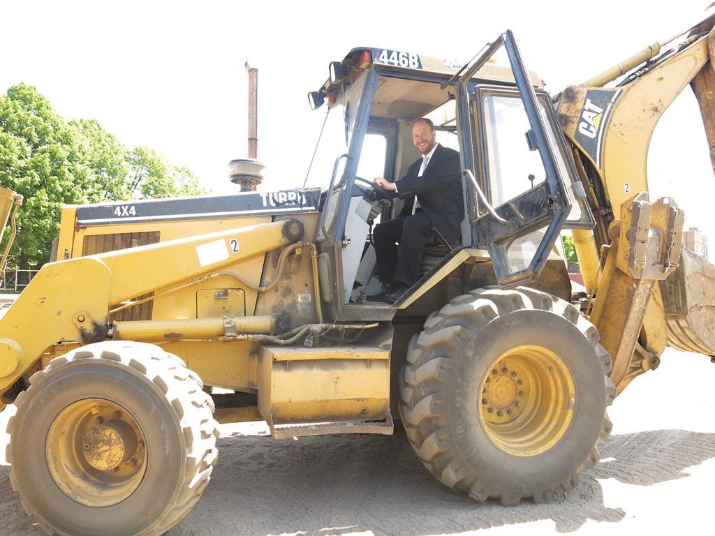 Councilman David Greenfield on Thursday rides a tractor during a ground breaking ceremony to mark the beginning of renovations to the 18th Avenue Park. (Office of Councilman Greenfield)