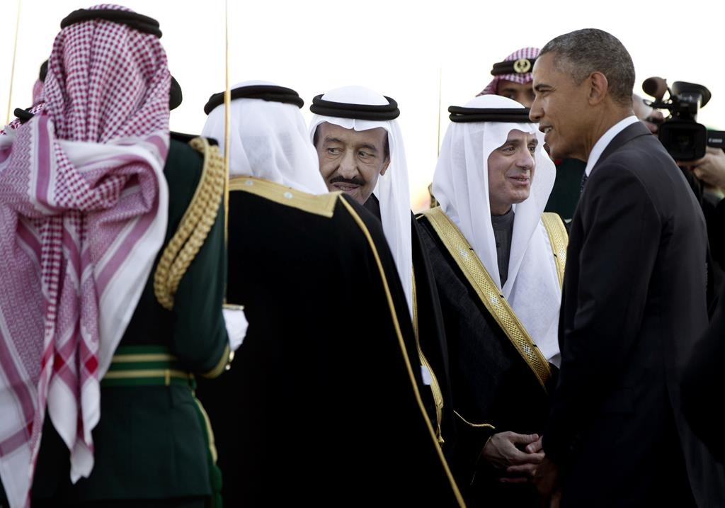 In this Tuesday, Jan. 27, 2015 file photo, President Barack Obama is greeted by Saudi King Salman bin Abdul Aziz as the president arrived at King Khalid International Airport, in Riyadh, Saudi Arabia.  (AP Photo/Carolyn Kaster)