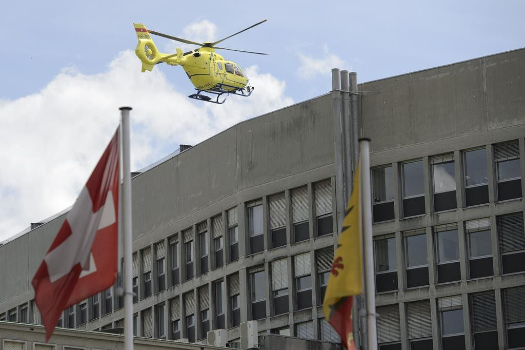 A helicopter takes off at the General Hospital in Geneva, Switzerland, Sunday. Secretary of State John Kerry broke his leg in bike crash outside of Geneva on Sunday and called off the rest of a four-nation diplomatic trip. (Martial Trezzini/Keystone via AP)