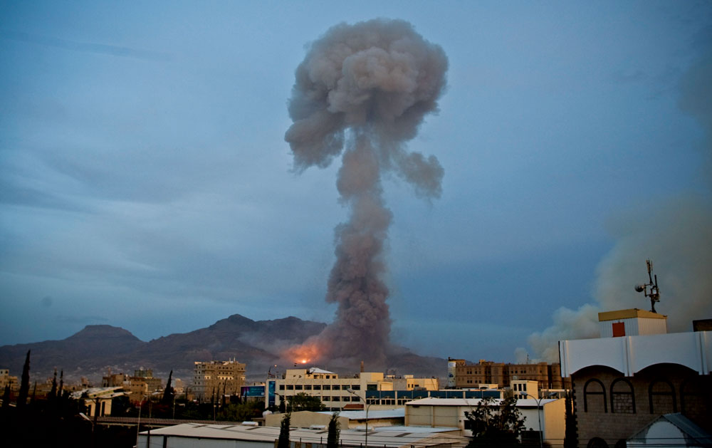 Smoke rises after a Saudi-led airstrike hit a site believed to be a munitions storage, in Yemen's capital, Sanaa, on Monday.  (AP Photo/Hani Mohamme)