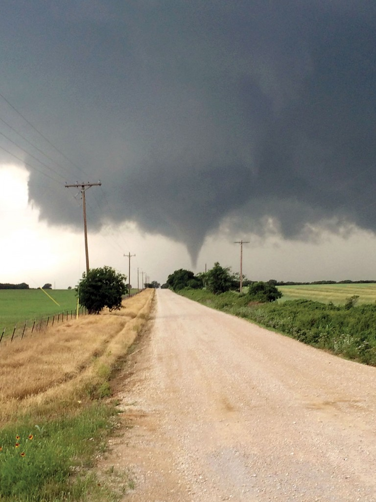 In this Saturday, May 9, photo provided by Brian Khoury, a tornado touches down in Cisco, Texas. One person was killed Saturday night and another left in critical condition after the tornado hit Cisco, a rural farming and ranch area about 100 miles west of Fort Worth. (Brian Khoury via AP)