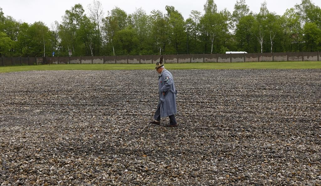 An elderly man walks over the memorial site for the former Nazi concentration camp in Dachau, southern Germany, Sunday, during an event to commemorate the 70th anniversary of the liberation of the camp. (AP Photo/Matthias Schrader)