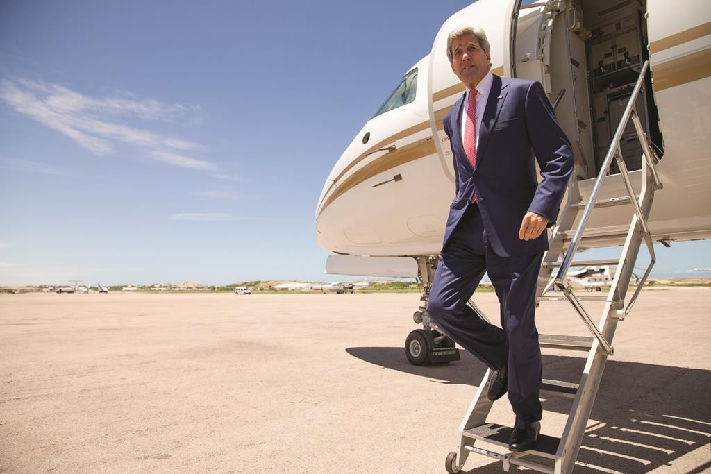 Secretary of State John Kerry arrives at the airport in Mogadishu, Somalia, Tuesday. (AP Photo/Andrew Harnik, Pool)