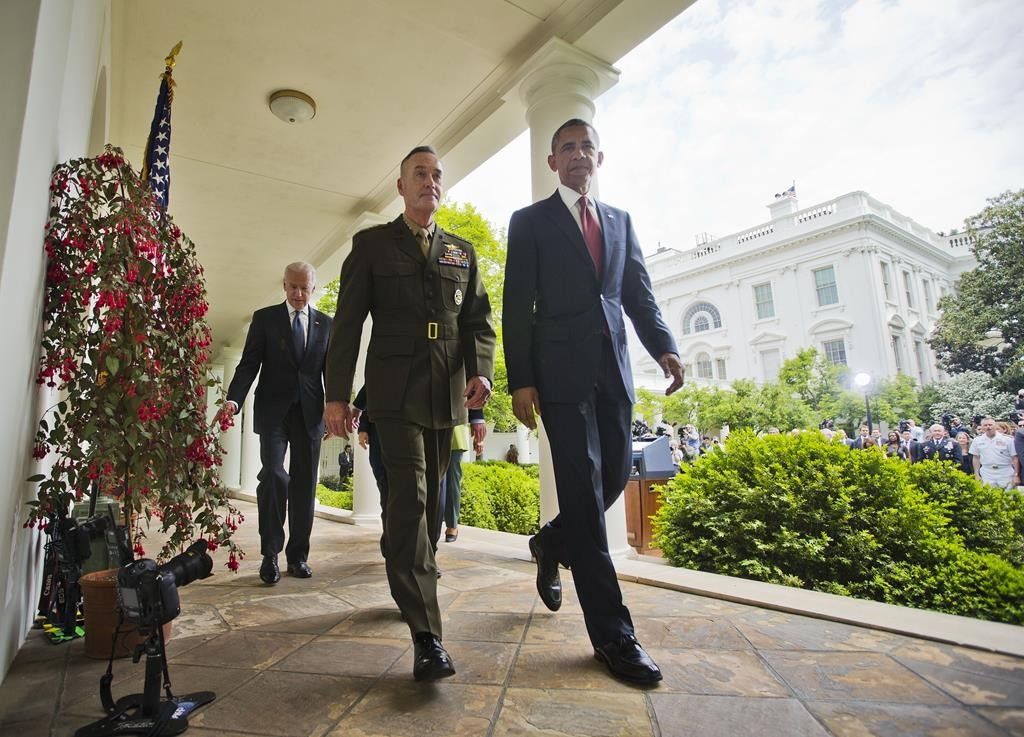 President Obama walks with Marine Gen. Joseph Dunford Jr., his nominee to be the next chairman of the Joint Chiefs of Staff, after speaking in the Rose Garden of the White House in Washington, Tuesday (AP Photo/Pablo Martinez Monsivais)