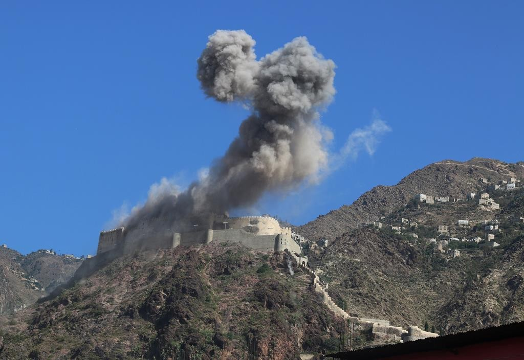 Smoke rises from al-Qahira castle, an ancient fortress that was recently taken over by Shiite rebels, following a Saudi-led airstrike in Taiz city, Yemen, Tuesday. (AP Photo/Abdulnasser Alseddik)
