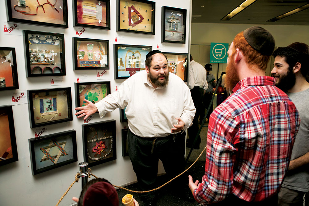 Zalmy, a member of the Friendship Circle of Brooklyn, for the developmentally disabled, on Sunday shows off his artwork at the Jewish Children's Museum in Crown Heights. (Friendship Circle of Brooklyn)