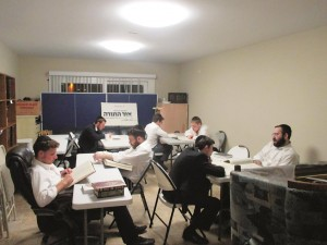 Bachurim at Yeshiva Gedolah Ohr Hatorah learning night seder, in an area of the dormitory set up as a beis medrash, in compliance with the 10:00 p.m. city-imposed curfew.