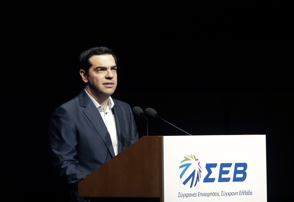 Greek Prime Minister Alexis Tsipras gives a speech at the annual conference of the Hellenic Federation of Enterprises in Athens on Monday, May 18, 2015. (AP Photo/Petros Giannakouris)