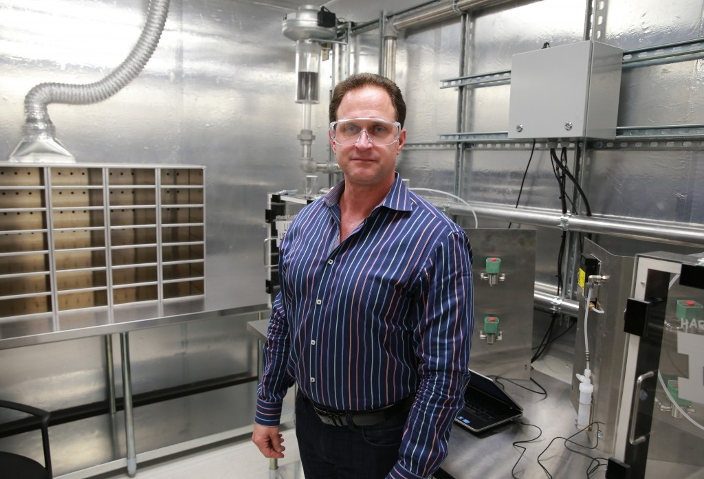 """Rob Lynch, CEO of Lumber Liquidators, poses for a photo at the quality testing lab at a Lumber Liquidators distribution center in Sandston, Va., on March 13, 2015. On Thursday, May 21, 2015, the company said that Lynch had resigned """"unexpectedly."""" The company has been embroiled in an investigation over products imported from China. (Daniel Sangjib Min/Richmond Times-Dispatch via AP)"""