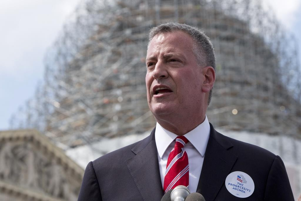 """Mayor Bill de Blasio speaks Tuesday about the """"Progressive Agenda"""" along with a coalition of backers on Capitol Hill in Washington. (AP Photo/Jacquelyn Martin)"""