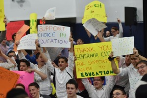 Yeshivah Shaare Torah students hold up signs urging an education tax credit during Gov, Andrew Cuomo's address on Sunday. (Office of the Governor/Kevin P. Coughlin)