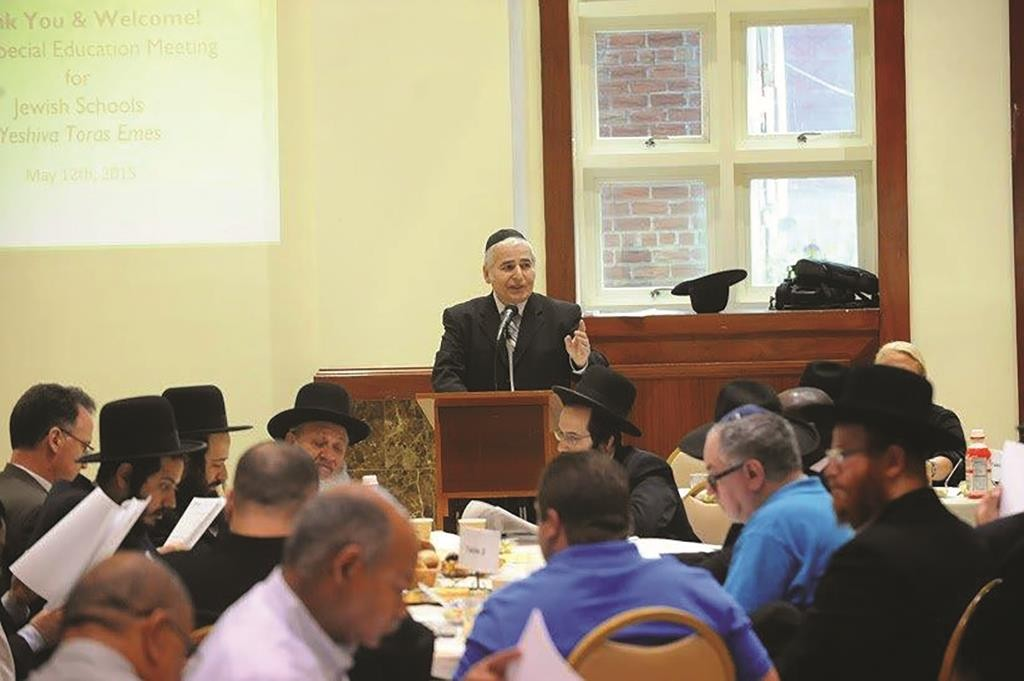 Rabbi Moshe Ausfresser addressing participants at the meeting.