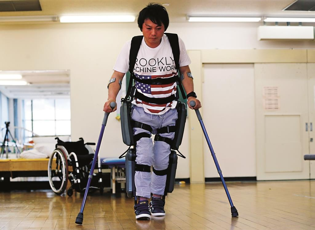 Yuichi Imahata walks using a robotic exoskeleton called ReWalk at Kanagawa Rehabilitation Center. (AP Photo/Shuji Kajiyama)