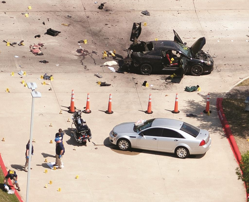 An aerial view shows the area around a car that was used the previous night by two gunmen, both killed by police, as it is investigated by local police and the FBI in Garland, Texas, Monday. (REUTERS/Rex Curry)