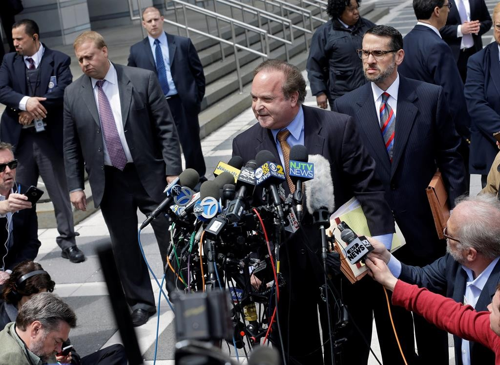 David Wildstein, center right, listens as his attorney Alan Zegas, center at podium, addresses the media as they leave federal court after a hearing Friday, in Newark, N.J.  (AP Photo/Mel Evans)