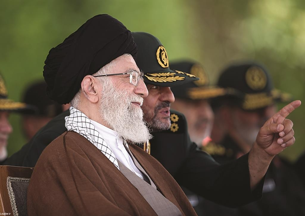 In this picture released by the official website of the office of the Iranian supreme leader on Wednesday, May 20, Supreme Leader Ayatollah Ali Khamenei listens to Revolutionary Guard commander Mohammad Ali Jafari during a graduation ceremony of a group of the guard's officers in Tehran, Iran. Iran's supreme leader vowed he will not allow international inspection of Iran's military sites or access to Iranian scientists under any nuclear agreement with world powers. (Office of the Iranian Supreme Leader via AP)