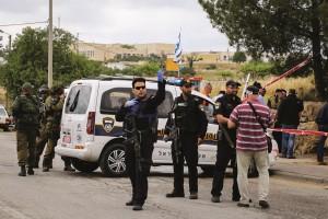 Israeli security personnel on the scene where a Palestinian attacker drove into four people near Alon Shvut, Gush Etzion, on Thursday.(Gershon Elinson/Flash90)