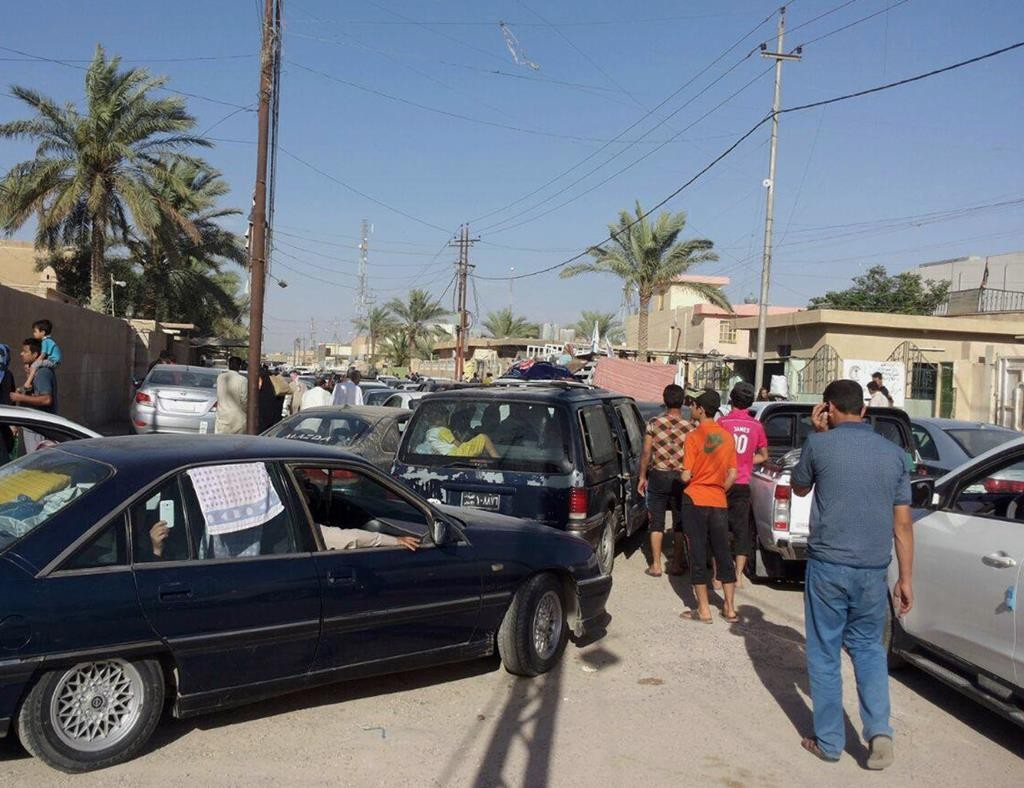 Civilians flee their hometown of Ramadi, the capital of Iraq's Anbar province, 70 miles west of Baghdad, Monday. (AP Photo)