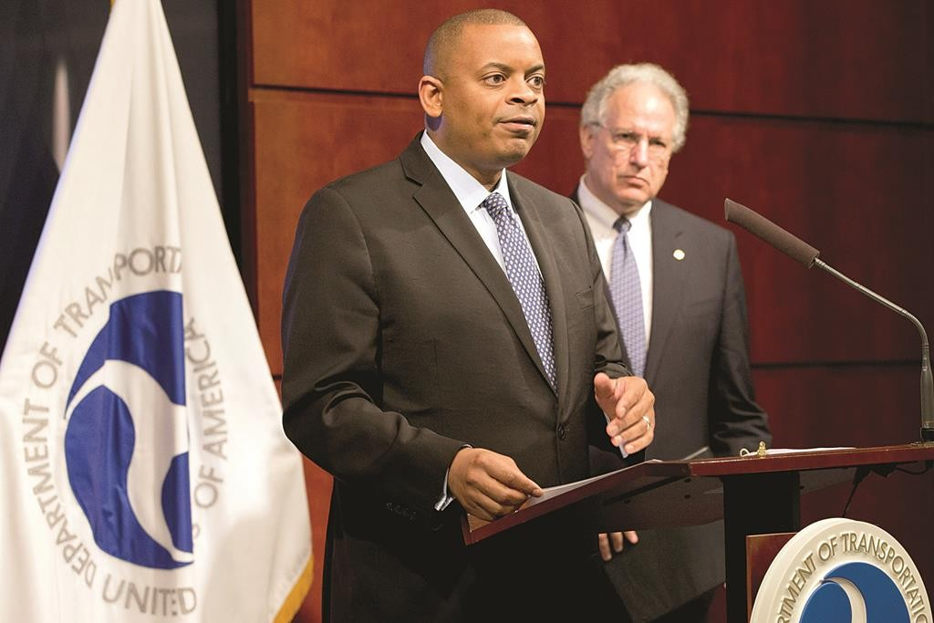 Transportation Secretary Anthony Foxx, left, accompanied by NHTSA Administrator Mark Rosekind, talks about the Takata air bag inflator recall, Tuesday, at the Transportation Department in Washington. (AP Photo/Jacquelyn Martin)